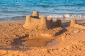 Sandcastle - concept of making save building — Stock Photo