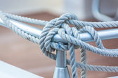 Mooring rope tied around steel anchor — Stock Photo