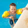 Happy boy having a fun at swimming pool — Stock Photo