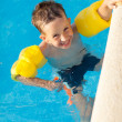 Smiling boy having a fun at swimming pool — Stock Photo