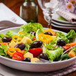Vegetable salad with olives and cheese — Stock Photo