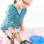 Casual schoolgirl painting — Stock Photo #30671093