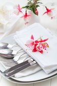Fine dining - table decorated with flowers — Stock Photo