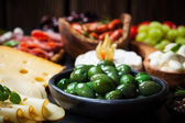 Antipasto with green olives — Stock Photo