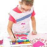 Schoolgirl painting — Stock Photo #33152455