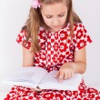 Schoolgirl reading book — Stock Photo