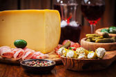 Antipasto catering platter with cheese loaf — Stock Photo