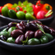 Variation of olives with raw snack vegetable — Stock Photo #42680473