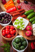 Raw snack with antipasti — Stock Photo
