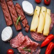 Platter of antipasti and appetizers — Stock Photo #48096765