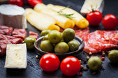 Platter of antipasti and appetizers — Stock Photo