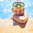 Happy girl with goggles in swimming pool — Stock Photo #49362027
