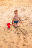 Small boy crying on the beach — Stock Photo
