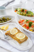 Baked fish fillet wih couscous salad — Stock Photo