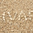 Stock Photo: HVAR word made of pebbles, authentic picture of Hvar's beach