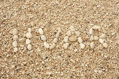 HVAR word made of pebbles, authentic picture of Hvar's beach — Stock Photo