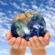 Stock Photo: Hands of womholding globe, Africand Near East