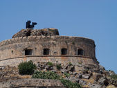 Fort Spinalonga main tower, black flags — Stock Photo