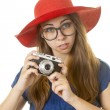 Geeky girl with camera — Stock Photo