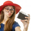 Geeky girl with camera — Stock Photo #28540687