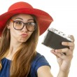 Geeky girl with camera — Stockfoto