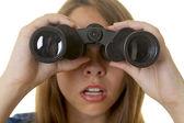 Young woman with binoculars — Stock Photo