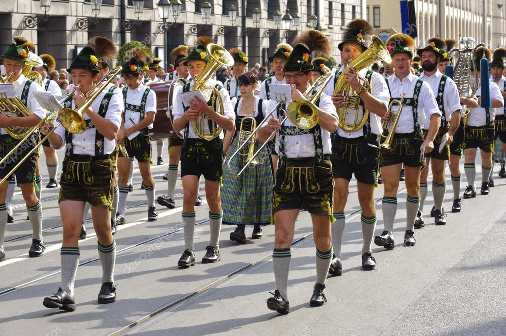 MUNICH, GERMANY - SEPTEMBER 23: a music brass band in traditional bavarian clothes participates in the opening parade of world biggest beer festival Oktoberfest  Stock Photo #13294013