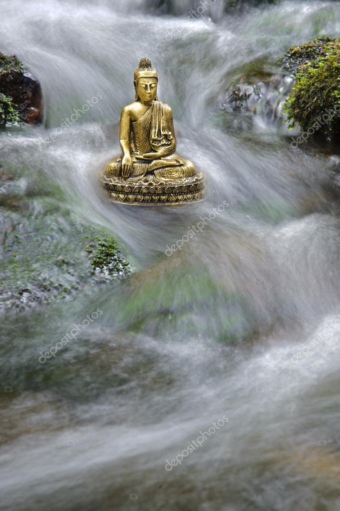 Buddha sitting in flowing water  Stock Photo #13400760
