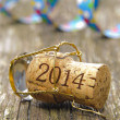 Stock Photo: Champagne cork opened for new year's party 2014