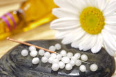 Alternative medicine with acupuncture and homeopathy — Stock Photo