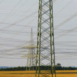 Panorama of electric pylons — Stock Photo