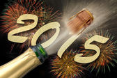 Popping Champagne and firework for new year 2015 — Stock Photo