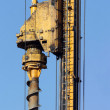 Head of the pile drilling mashine - Stock Photo