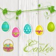 Stock Vector: Hanging easter eggs on wood