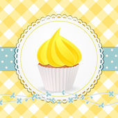 Cupcake with yellow icing on yellow gingham background — Stock Vector