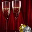 Champagne and christmas baubles on a red background — Stock Vector #7660435