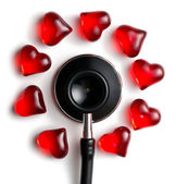 Stethoscope and red hearts — Stock Photo