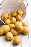 Raw potatoes in colander — Stock Photo