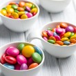 Colored candy in white bowl — Stock Photo
