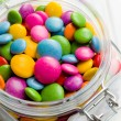Colored candy in glass jar — Stock Photo