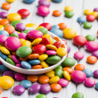 Colored candy in white bowl - Stock fotografie