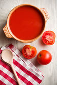 Tomato soup on kitchen table — Stock Photo