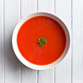 Tomato soup on kitchen table — Foto de Stock