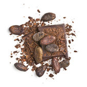 Chocolate pieces with cocoa beans — Stock Photo