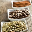 Green, roasted, ground and instant coffee - Stock Photo