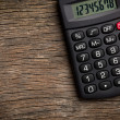 Calculator on old wooden table — Foto de Stock