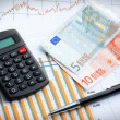Calculator and euro currency on business graph. — Stock Photo
