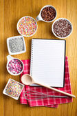 Recipe book with a variety of candy sprinkles. — Stock Photo