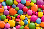 Three different sizes of colorful candies — Stock Photo
