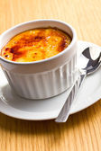 Creme brulee in ceramic bowl — Stock Photo